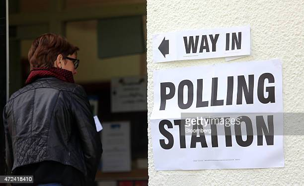 A voter enters a polling station to cast a vote in the general election in Hull UK on Thursday May 7 2015 Britain votes on Thursday in the most...