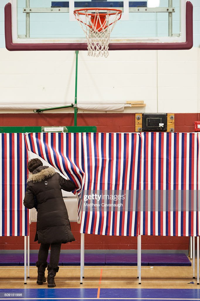 A voter enters a voting booth on February 9, 2016 at Broken Ground School in Concord, New Hampshire. . Voters throughout the state are heading to the polls as the New Hampshire Primary, also known as the first-in-the-nation primary, continues the process of selecting the next president of the United States.