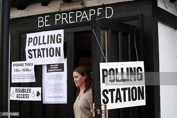 A voter exits a polling station located inside a scout hut as voting continues in the general election in Oxford UK on Thursday May 7 2015 Britain...