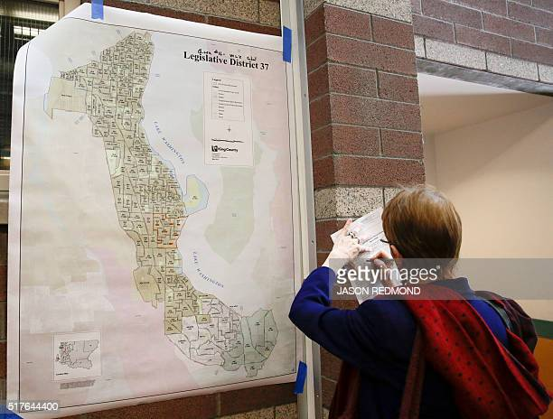 A voter fills out paper to participate in Washington State Democratic Caucuses at Martin Luther King Elementary School in Seattle on March 26 2016 /...