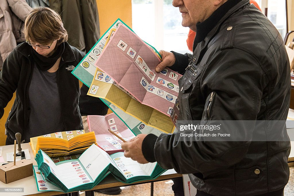 A voter gets ready to cast his ballot at a polling station on February 24, 2013 in Rome, Italy. Italians are heading to the polls today to vote in the elections, as the country remains in the grip of economic problems . Pier Luigi Bersani's centre-left alliance is believed to be a few points ahead of the centre-right bloc led by ex-Prime Minister Silvio Berlusconi.