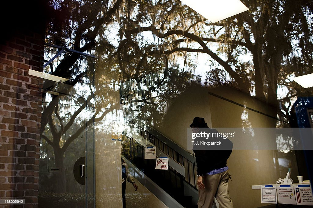 A voter heads to the polling room in the Micanopy Town Hall to vote in the state's Republican party primary on January 31, 2012 in Micanopy, Fla. After a decisive South Carolina win, former House speaker Newt Gingrich has risen and fallen in the polls and trails former Massachusetts Gov. Mitt Romney by double digits going in to Florida's primary.
