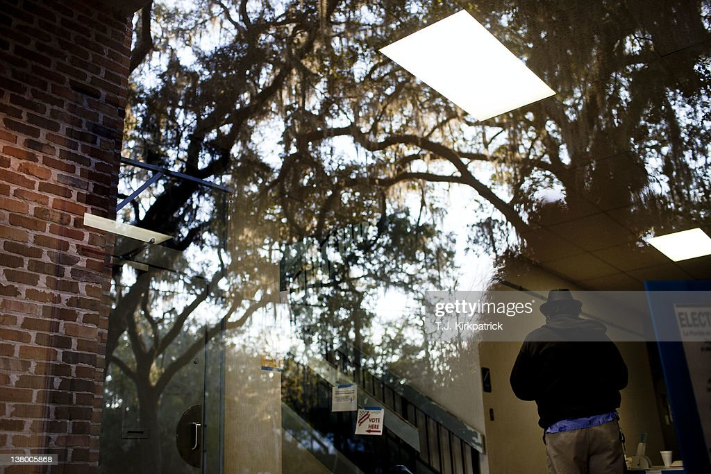 A voter heads to the polling room in the Micanopy Town Hall to vote in the state's Republican Party primary on January 31, 2012 in Micanopy, Florida. After a decisive South Carolina win, former House speaker Newt Gingrich has risen and fallen in the polls and trails former Massachusetts Gov. Mitt Romney by double digits going in to Florida's primary.