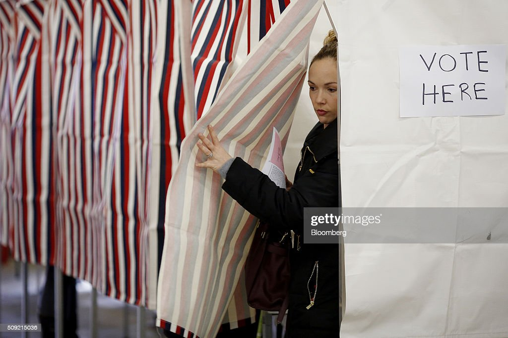 A voter leaves a booth at a polling station inside the Newmarket Fire Department in Newmarket, New Hampshire, U.S., on Tuesday, Feb. 9, 2016. Voters in New Hampshire took to the polls today in the nation's first primary in the U.S. presidential race. Photographer: Luke Sharrett/Bloomberg via Getty Images