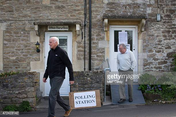 A voter leaves a polling station located in the converted coach house in the village of Farleigh Hungerford on May 7 2015 in Somerset England The...