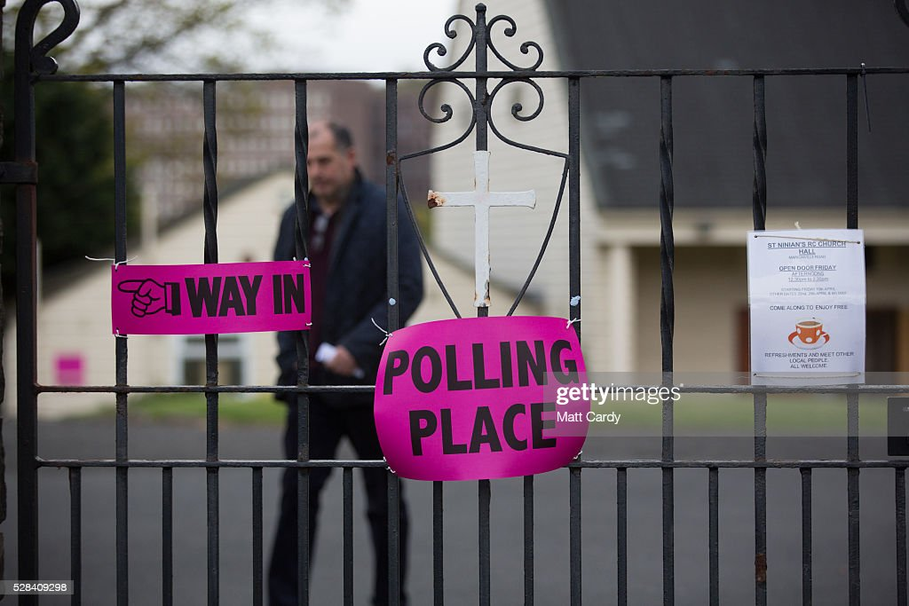 A voter leaves St Ninian & Triduana RC Church after voting in the Scottish Parliament elections on May 5, 2016 in Edinburgh, Scotland. Today, dubbed 'Super Thursday', sees the British public vote in countrywide elections to choose members for the Scottish Parliament, the Welsh Assembly, the Northern Ireland Assembly, Local Councils, a new London Mayor and Police and Crime Commissioners. There are around 45 million registered voters in the UK and polling stations open from 7am until 10pm.