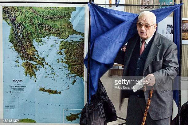 A voter leaves the polling booth at a polling station in a school in a suburb of Athens on January 25 2015 near Athens Greece According to the latest...