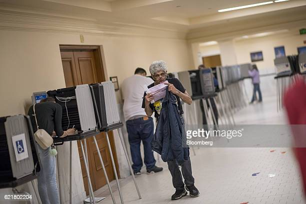 A voter licks an envelope containing his ballot at the San Francisco City Hall polling location in San Francisco California US on Tuesday Nov 8 2016...