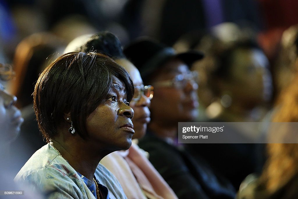A voter listens to Democratic presidential candidate Hillary Clinton speak in South Carolina a day after her debate with rival candidate Bernie Sanders on February 12, 2016 in Denmark, South Carolina. Clinton is counting on strong support from the African American community in South Carolina to give her a win over Sanders in the upcoming primary on February 27.