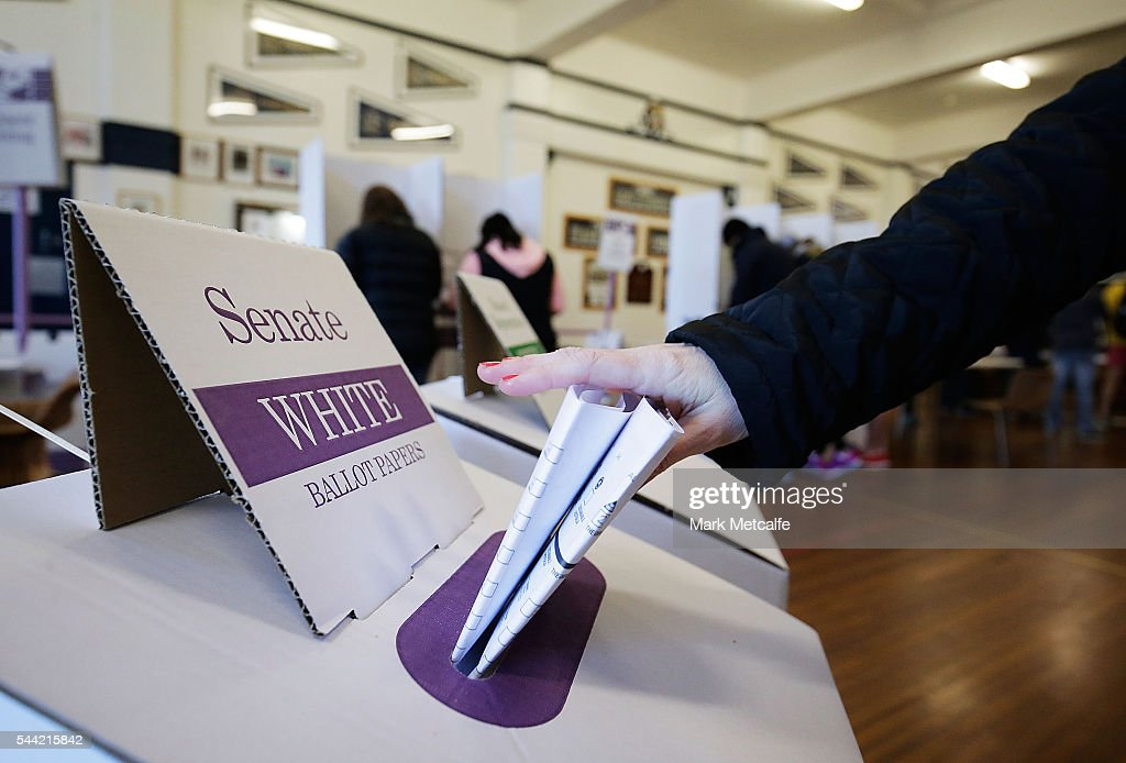 A voter places a ballot paper in a ballot box at Bondi Surf Bathers' Life Saving Club in the electorate of Wentworth on July 2, 2016 in Sydney, Australia. Voters head to the polls today to elect the 45th parliament of Australia.