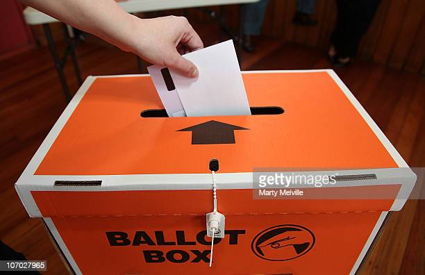 A voter places a ballot paper into the ballot box during the Mana ByElection at Cannons Creek School polling booth on November 20 2010 in Wellington...