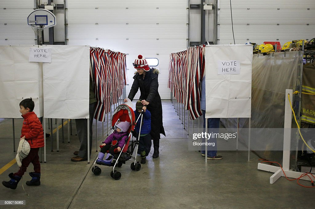 A voter pushes a stroller through the polling station at the Newmarket Fire Department in Newmarket, New Hampshire, U.S., on Tuesday, Feb. 9, 2016. Voters in New Hampshire took to the polls today in the nation's first primary in the U.S. presidential race. Photographer: Luke Sharrett/Bloomberg via Getty Images