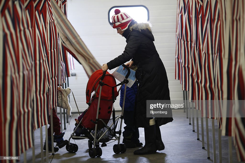 A voter pushes a stroller through the polling station inside the Newmarket Fire Department in Newmarket, New Hampshire, U.S., on Tuesday, Feb. 9, 2016. Voters in New Hampshire took to the polls today in the nation's first primary in the U.S. presidential race. Photographer: Luke Sharrett/Bloomberg via Getty Images