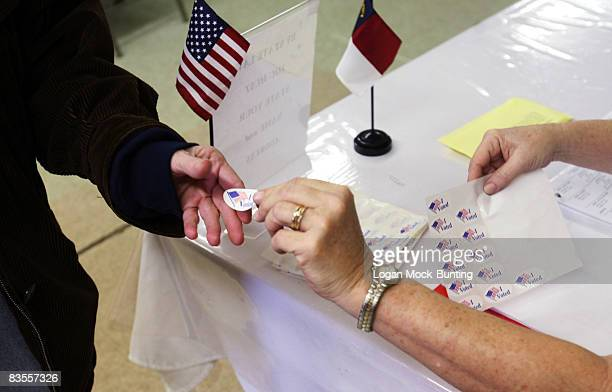 A voter receives an 'I Voted' sticker at the local polling station on November 4 2008 in Currie North Carolina After nearly two years of presidential...
