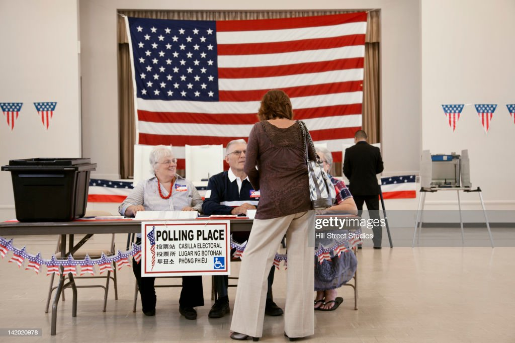Voter registering at polling place