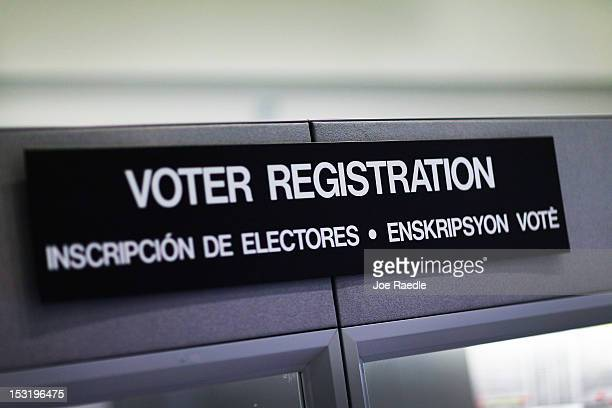 A voter registration sign hangs at the MiamiDade Election Department on October 1 2012 in Miami Florida With the October ninth deadline for people to...