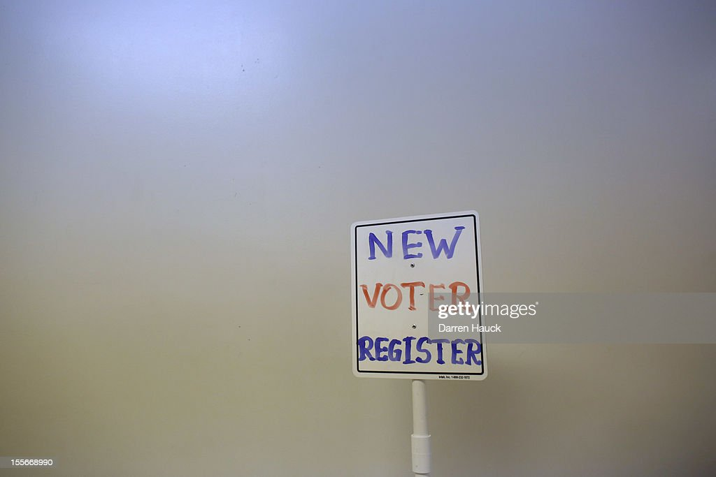 A voter registration sign is seen at a polling station on November 6 2012 in Richmond Wisconsin As Americans are heading to the ballots polls show...