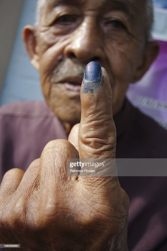 A voter shows his inked finger after casting his vote on May 5, 2013 in Penanti, Penang, Malaysia. Millions of Malaysians cast their vote on Sunday in one of the most tightly contested Malaysian election since independence in 1957. The opposition coalition, Pakatan Rakyat (People's Alliance), led by former deputy prime minister Anwar Ibrahim is seeking to gain power on a national level against the ruling party Barisan Nasional.