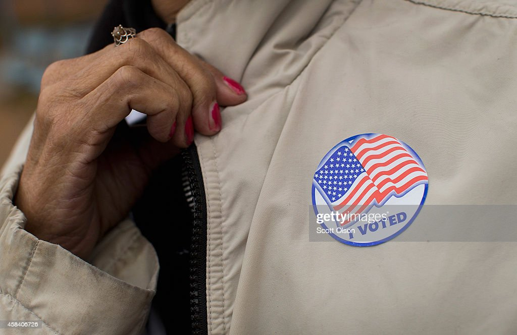 A voter shows off her 'I Voted' sticker as she leaves a polling place on November 4 2014 in Ferguson Missouri In last Aprils election only 1484 of...