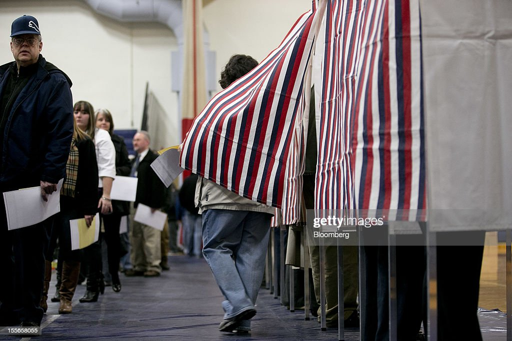 A voter steps out of a booth at a polling station in Manchester, New Hampshire, U.S., on Tuesday, Nov. 6, 2012. U.S. President Obama is seeking to overcome the drag of high unemployment and economic weakness that has frustrated predecessors' re-election bids, while his Republican rival Mitt Romney reaches for an upset to propel him beyond his party's standing and swamp an electoral map stacked against him on the final day of the presidential race. Photographer: Andrew Harrer/Bloomberg via Getty Images