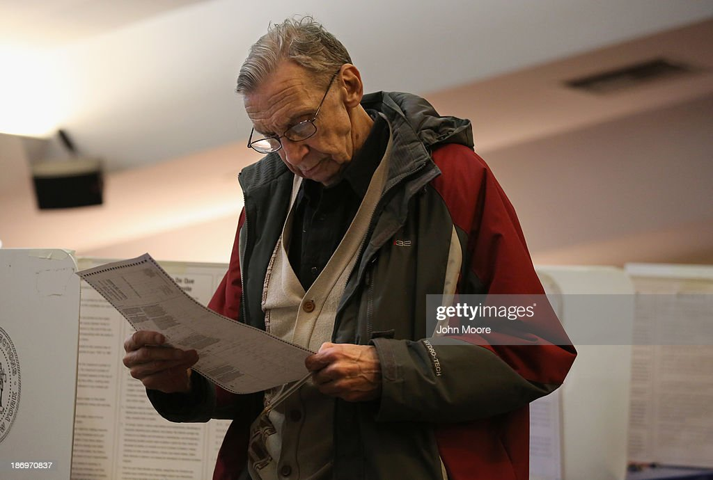 A voter studies his completed ballot at a polling station on November 5, 2013 in the Brooklyn borough of New York City. New Yorkers went to the polls to choose between Democratic candidate Bill de Blasio and Republican Joe Lhota. De Blasio was widely considered the favorite going into election day.