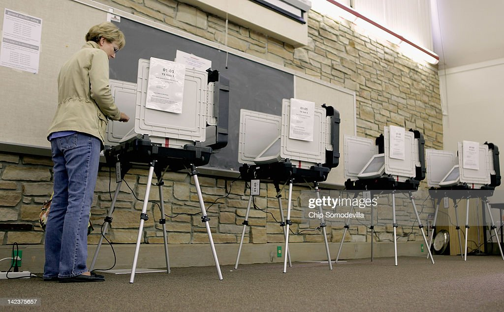 A voter uses a digital voting machine during the presidential primary election at the Agricultural History Farm Park April 3 2012 in Derwood Maryland...