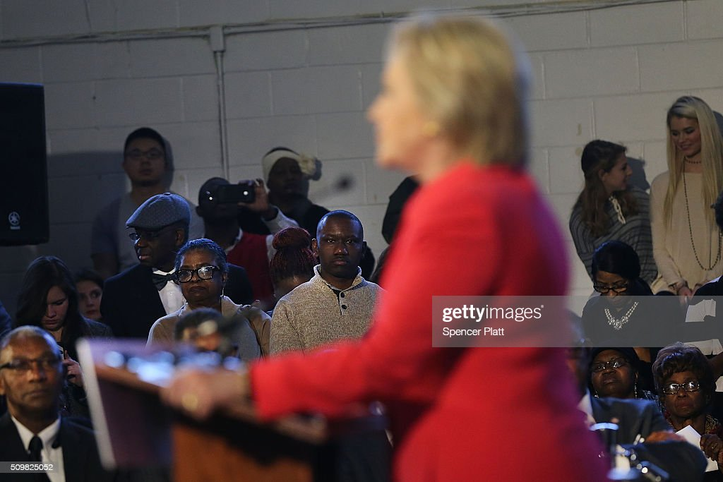Voters and elected officals listen to Democratic presidential candidate Hillary Clinton speak in South Carolina a day after her debate with rival candidate Bernie Sanders on February 12, 2016 in Denmark, South Carolina. Clinton is counting on strong support from the African American community in South Carolina to give her a win over Sanders in the upcoming primary on February 27.