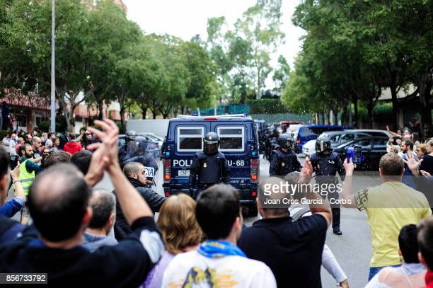 Voters and Spanish national police officers during the Catalonia independence referendum declared ilegal by the Spanish government on October 1 2017...