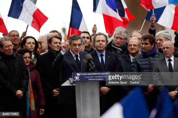 Voters are holding flags as Former Prime Minister and Presidential Candidate Francois Fillon gives a political meeting at Trocadero on March 5 2017...