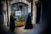 Voters arrive at a polling station at the Christ Church Church of England Primary School in Brick Lane on May 22 2014 in London England Millions of...