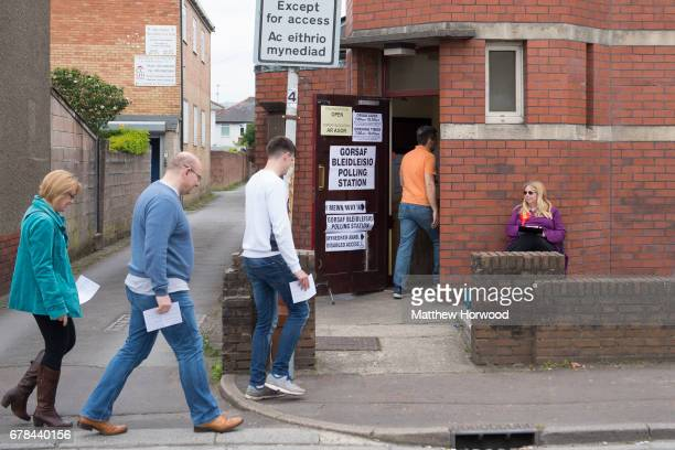 Voters arrive at a polling station during the local council elections on May 4 2017 in Birchgrove Cardiff Wales A total of 4851 council seats are up...