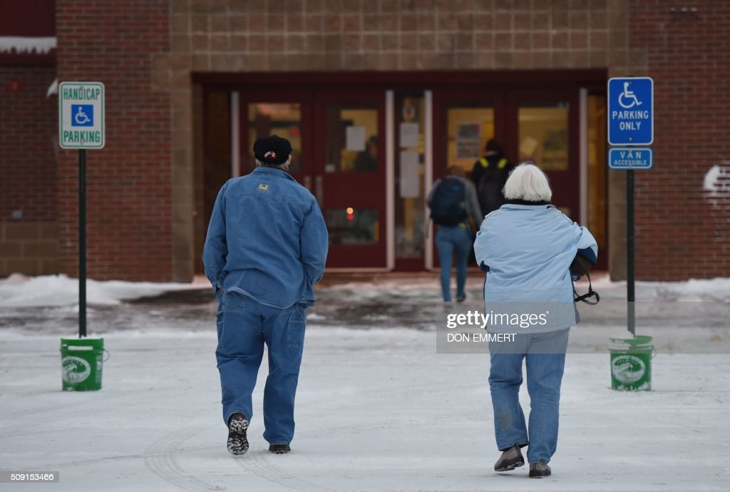 arrive at Belmont High School to cast their votes February 9, 2016 ...