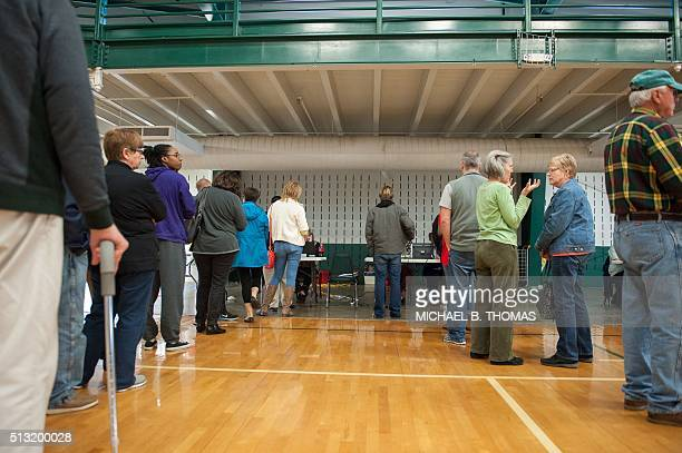 Voters arrive to be checked in at McGee Community Center on March 1 2016 in Conway Arkansas / AFP / Michael B Thomas