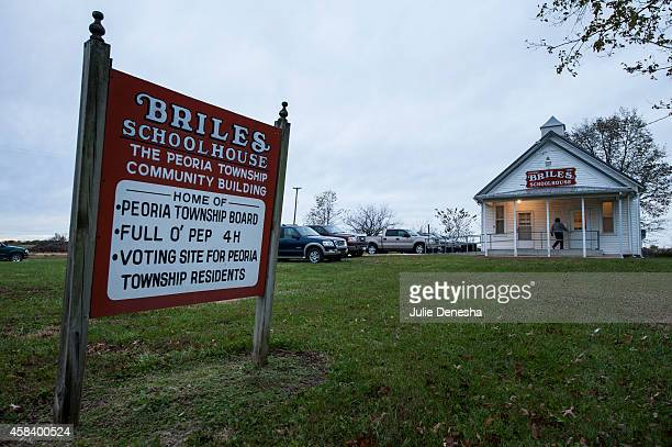 Voters arrive to cast their ballots at a former schoolhouse November 4 2014 in Wellsville near Ottawa Kansas A tight race between independent...