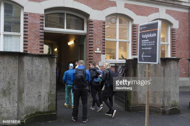 Voters arrive to vote at a polling station on the final day of the parliamentary vote in Oslo Norway on Monday Sept 11 2017 Norwegians head for the...