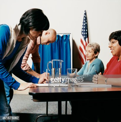 Voters at a Polling Station : Stock Photo