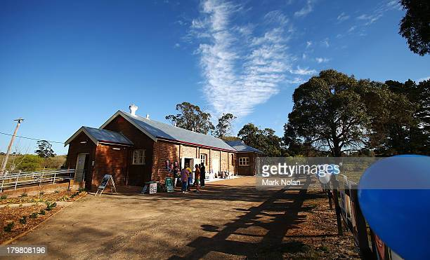 Voters attend a polling booth in the electorate of Throsby on election day on September 7 2013 in Sutton Forest Australia Voters head to the polls...