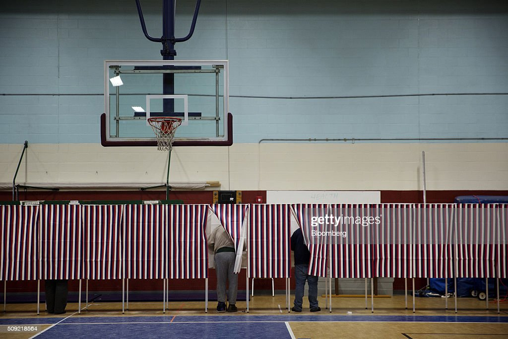 Voters cast ballots at a polling station inside Broken Gound Elementary School in Concord, New Hampshire, U.S., on Tuesday, Feb. 9, 2016. Voters in New Hampshire took to the polls today in the nation's first primary in the U.S. presidential race. Photographer: Victor J. Blue/Bloomberg via Getty Images