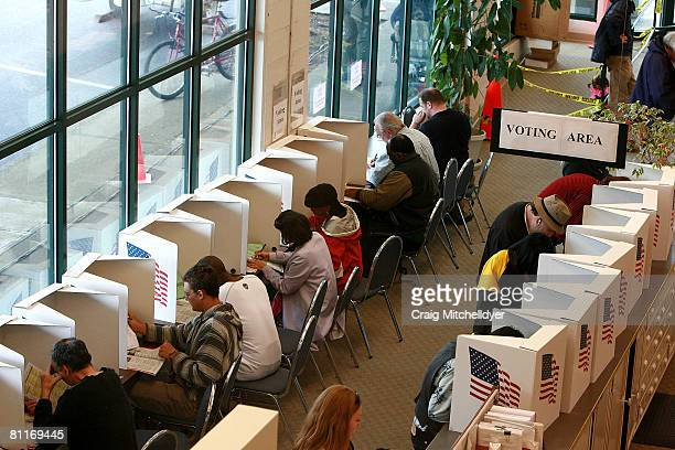 Voters cast ballots at the Multnomah County elections office May 20 2008 in Portland Oregon Senator Barack Obama is the favorite to win the...