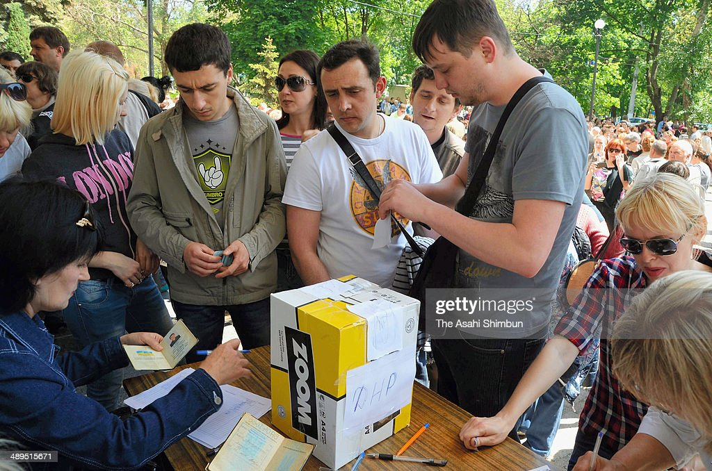 Voters cast ballots into a cardboard box in eastern Ukraine's independence referendum on May 11, 2014 in Mauripol, Ukraine. The referendum for greater autonomy is being held after pro-Russian activists took over at least ten cities in the eastern part of the country in a bid for less control from the central government from Kiev.