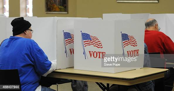 Voters cast their ballots at a polling station at the Community Center November 4 2014 in Brooklyn Iowa Brooklyn is the hometown of Democratic Senate...