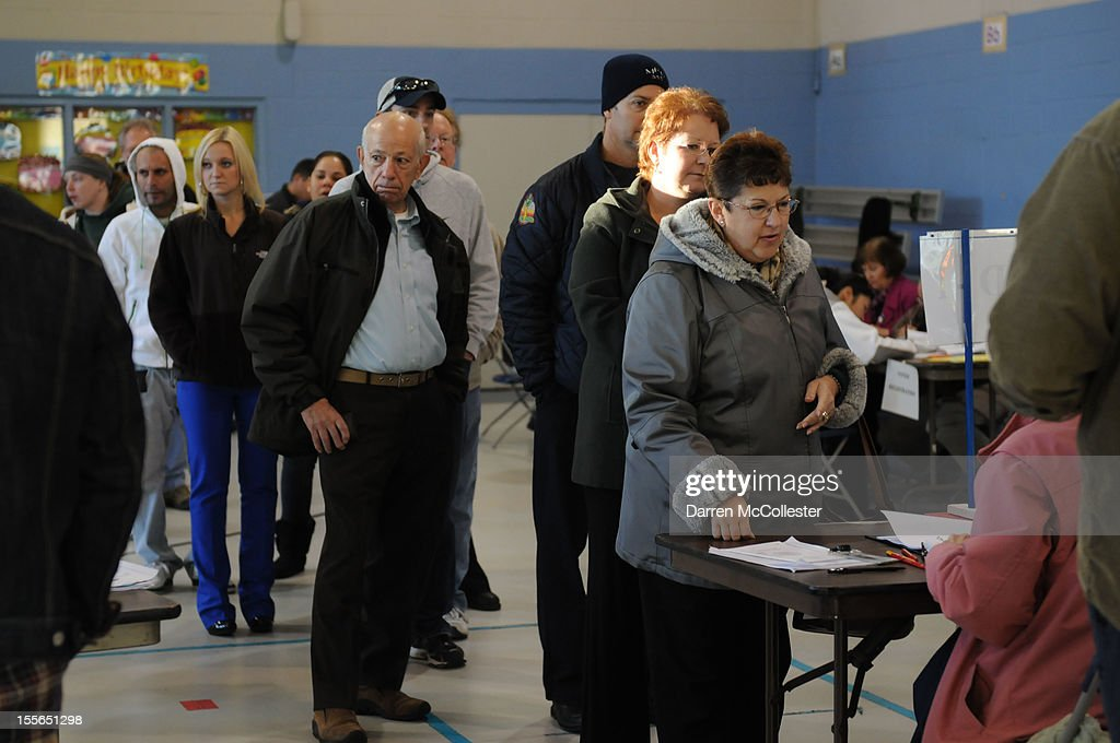 Voters cast their ballots at the Bishop Leo O'Neil Youth Center on November 6, 2012 in Manchester, New Hampshire. The swing state of New Hampshire is recognised to be a hotly contested battleground that offers 4 electoral votes, as recent polls predict that the race between U.S. President Barack Obama and Republican presidential candidate Mitt Romney remains tight.