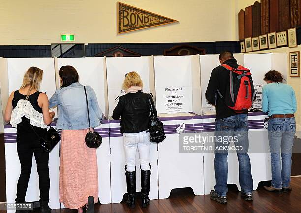 Voters cast their ballots at the Bondi Beach Surf Life Saving Club polling station in Sydney on August 21 2010 Australians voted in the tightest...