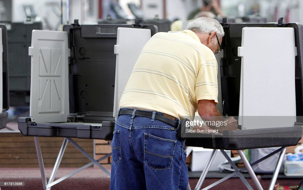 Voters cast their ballots at the Francis Collins Fitness Center Tuesday, March 13, 2012, in Gulfport, Miss.