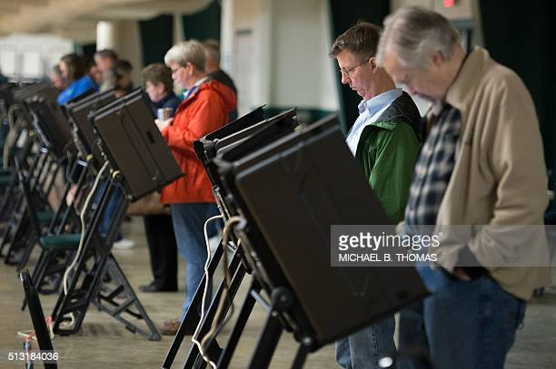 Voters cast their ballots at the McGee Community Center on March 1 2016 in Conway Arkansas Americans began voting in the crucial Super Tuesday...