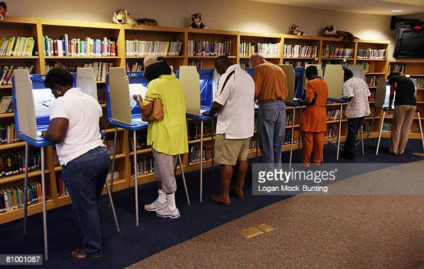 Voters cast their ballots at the Williston Middle School polling station the morning of May 6 2008 in Wilmington North Carolina Voters in Indiana and...
