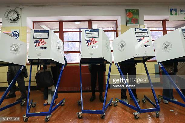 Voters cast their ballots at voting booths at PS198M The Straus School on November 8 2016 in New York United States