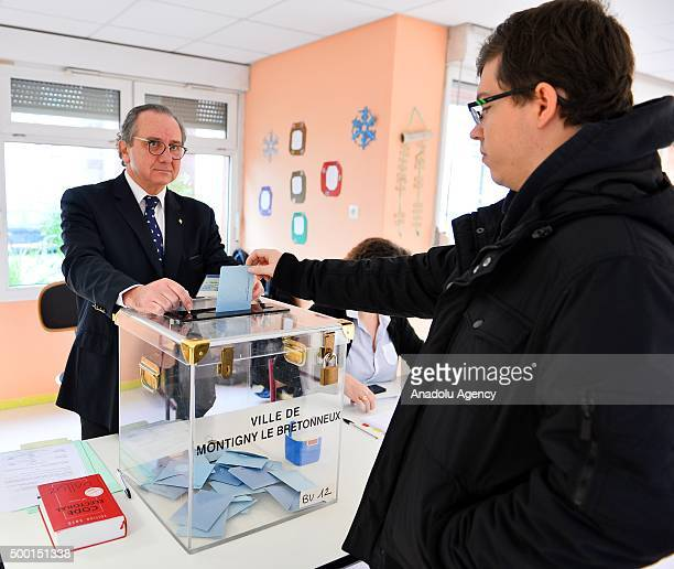 Voters cast their ballots for the France regional elections at a polling station in Paris France on December 6 2015 Polling stations opened in France...