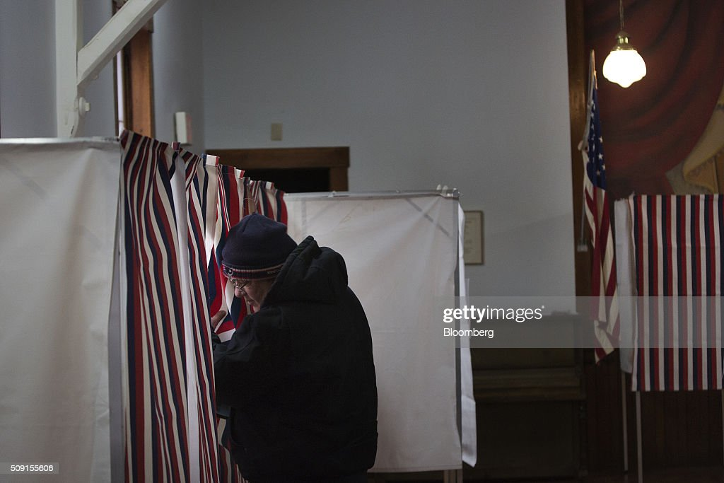 Voters cast their ballots in the first-in-the-nation New Hampshire presidential primary at the Chichester Town Hall in Chichester, New Hampshire, U.S., on Tuesday, Feb. 9, 2016. Polls suggest that Trump maintains a dominant lead against his rivals in New Hampshire ahead of todays primary. Photographer: Victor J. Blue/Bloomberg via Getty Images