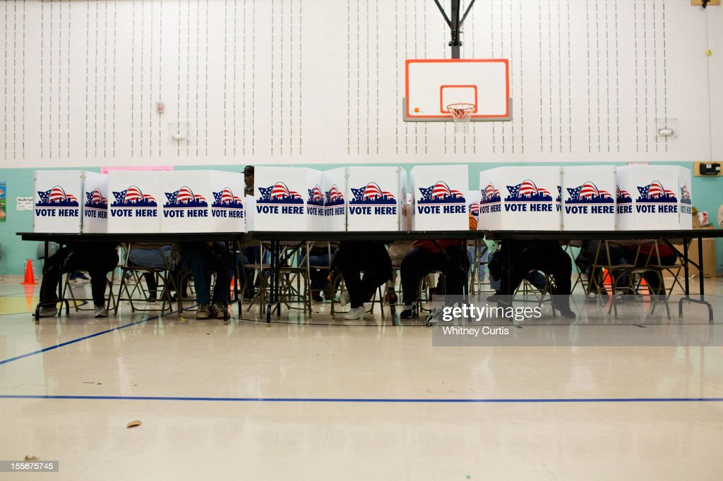 Voters cast their ballots in the general election November 6, 2012 at Earl Nance Sr. Elementary School in St. Louis, Missouri. As Americans go to vote, U.S. President Barack Obama and Republican presidential candidate Mitt Romney are in a virtual tie in the national polls.